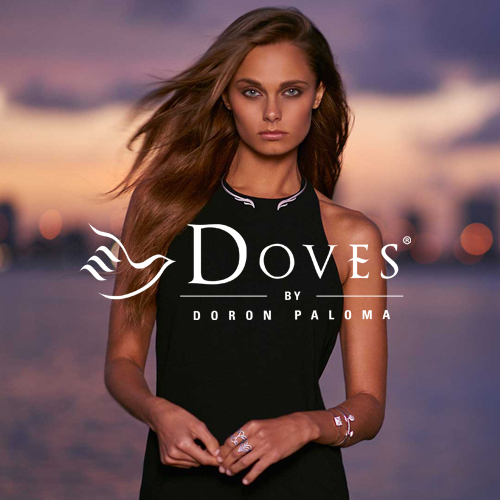Doves by Doron Paloma. Avialable at Connie and V. Cross Jewelers.